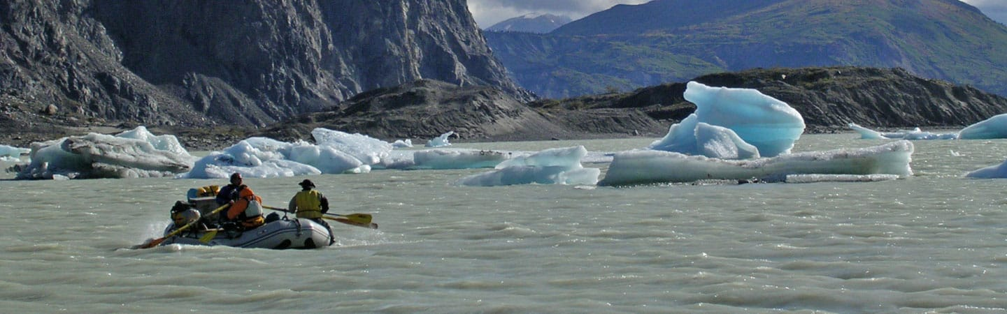 Rowing across Lowell Lake on the Alsek River