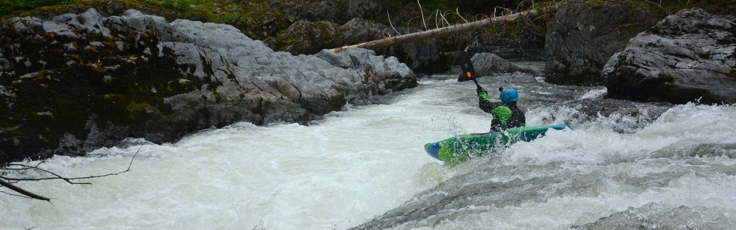 A kayaker runs First Drop on Canyon Creek.